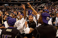 Washington players celebrate after winning the Pac-10 championship. The Washington Huskies defeated the California Golden Bears 79-75 during the championship game of the Pacific Life Pac-10 Conference Tournament at Staples Center in Los Angeles, California on March 13th, 2010.