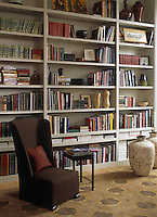 The floor-to-ceiling bookcase in the study is interspersed with decorative ceramics