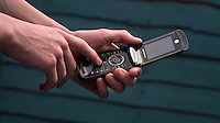 Person Using a Motorola Razr Mobile Phone - Jun 2014.