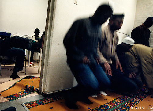 Illegal immigrants from Sierra Leone pray in a Muslim safe-house Amsterdam's Bijlmer area. .Picture taken 2002 by Justin Jin. ..