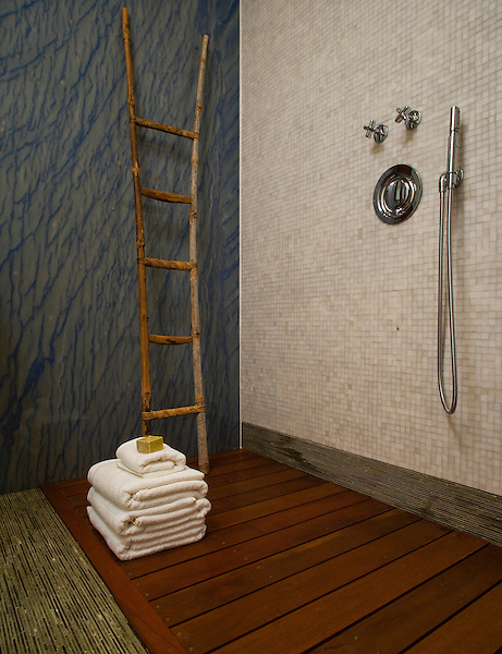 Tatami mosaic bath floor and base moldings in Chartreuse with Calacatta Tia marble mosaic walls and Blue Macauba slabs