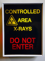 X-ray warning sign. View of an x-ray warning sign warning the reader that they are about to pass into a controlled area where there is a danger of x-ray exposure. Royalty Free