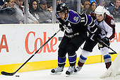 Anze Kopitar (Los Angeles Kings, #11) vs  John-Michael Liles (Colorado Avalanche, #4) during ice-hockey match between Los Angeles Kings and Colorado Avalanche in NHL league, February 26, 2011 at Staples Center, Los Angeles, USA. (Photo By Matic Klansek Velej / Sportida.com)