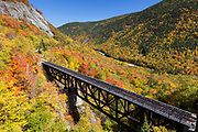 The Willey Brook Trestle along the old Maine Central Railroad in Hart's Location, New Hampshire during the autumn months. This trestle is within Crawford Notch State Park. And since 1995 the Conway Scenic Railroad, which provides passenger excursion trains has been using the track.
