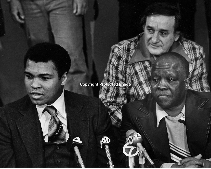 Heavy weight Champion Muhammad Ali with his trainer Dick Sadler at press conference.<br />