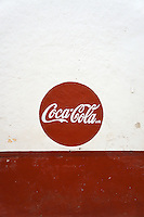 Coca Cola sign painted on the wall of a store  in Santa Elena, Yucatan, Mexico..