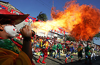 A participant blows fire through his mouth in Barranquilla Carnival, Colombia , Saturday, February 2, 2008..Born in Argentina, photographer Ivan Pisarenko in 2005  decided to ride his motorcycle across the American continent. While traveling Ivan is gathering an exceptional photographic document on the more diverse corners of the region. Archivolatino will publish several stories by this talented young photographer..Closer look at  Ivan's page www.americaendosruedas.com....