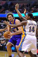 Pau Gasol of the Lakers is harassed by  Wizards' Al Thornton. Los Angeles defeated Washington 103-89 at the Verizon Center in Washington, DC on Tuesday, December 14, 2010. Alan P. Santos/DC Sports Box