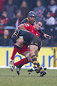 Nic Berry of London Wasps RFC upends Justin Melck of Saracens RFC with the assistance of Marco Wentzel (c) of London Wasps RFC - London Wasps RFC vs Saracens RFC - Aviva Premiership Rugby at Adams Park, Wycombe Wanderers FC - 12/02/12 - MANDATORY CREDIT: Ray Lawrence/TGSPHOTO - Self billing applies where appropriate - 0845 094 6026 - contact@tgsphoto.co.uk - NO UNPAID USE.