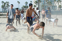 The Santa Monica High School varsity baseball team workouts at Santa Monica Beach on Tuesday, September 13, 2011.