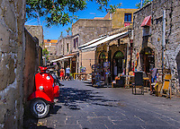 Fine Art Print Photograph. Classic street scene of a red scooter in the ancient streets of Rhodes, Greece.