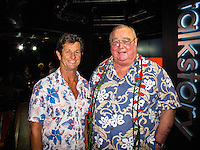 """HONOLULU, Turtle Bay Resort, North Shore, Oahu. - (Thursday, January 3, 2013)  Mark Warren (AUS) and Greg Noll (USA) who was the guest  speaker of Talk Story at Surfer The Bar tonight, Noll, nicknamed """"Da Bull"""" by Phil Edwards in reference to his physique and way of """"charging"""" down the face of a wave is an American pioneer of big wave surfing and is also acknowledged as a prominent longboard shaper. Noll was a member of a US lifeguard team that introduced Malibu boards to Australia around the time of the Melbourne Olympic Games. Noll became known for his exploits in large Hawaiian surf on the North Shore of Oahu. He first gained a reputation in November 1957 after surfing Waimea Bay in 25-30 ft surf when it had previously been thought impossible even to the local Hawaiians. He is perhaps best known for being the first surfer to ride a wave breaking on the outside reef at the so-called Banzai Pipeline in November 1964...It was later at Makaha, in December 1969, that he rode what many at the time believed to be the largest wave ever surfed. After that wave and the ensuing wipeout during the course of that spectacular ride down the face of a massive dark wall of water, his surfing tapered off and he closed his Hermosa Beach shop in the early 1970s. He and other surfers such as Pat Curren, Mike Stang, Buzzy Trent, George Downing, Mickey Munoz, Wally Froyseth, Fred Van Dyke and Peter Cole are viewed as the most daring surfers of their generation...Noll is readily identified in film footage while surfing by his now iconic black and white horizontally striped """"jailhouse"""" boardshorts and was interviewed by host Jodi Wilmott (AUS). . Photo: joliphotos.com"""