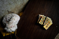 A pack of playing cards, designed for predicting the future, is seen on the table in a shaman's house in Cali, Colombia, 17 April 2013. Although the original spiritual tradition, kept by the indigenous shamen in Americas for centuries, has been systematically repressed by the Catholic Church, nowadays, more and more people from the urban areas of Latin America discover their roots and consult their everyday problems with esoteric practitioners, healers and shamen. Traditional indigenous rituals (reading of tobacco - interpretation of signs shown by burn tobacco leaves) have merged with European concepts (divination using playing cards) and animistic religious beliefs (worshipping the spirits) brought to Americas by the African slaves, keeping the spirituality in modern Latin American society alive.