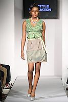 Model walks runway in an outfit from the SMARTER Clothing Fall 2012 collection, by Iliana Quander, during BK Fashion Weekend Fall Winter 2012.