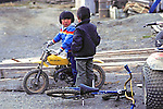 Little Boy On Mini Motorcycle