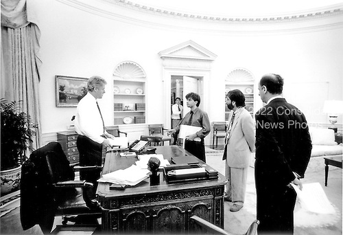 Washington, DC - (FILE) -- United States President Bill Clinton speaks with Communications Director George Stephanopoulos and other White House staffers in the Oval Office of the White House in Washington, D.C. on Friday, June 25, 1993..Credit: White House via CNP
