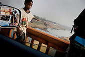 From West Africa Migrant serie..Near Kankan on river Millo. Guinea Conakry..In the last years a lot of people coming from Sierra Leone and Liberia come to Guinea Conakry. Many of them are migrants and travel through the country as they can looking for work and stability.