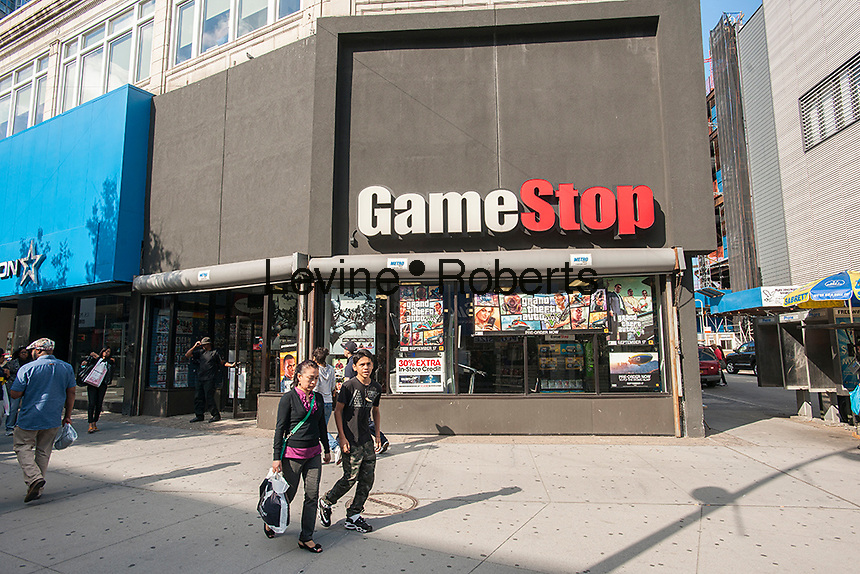 GameStop in Downtown Brooklyn in New York on Sunday, September 29, 2013. The area has been for years a middle and lower economic shopping strip but because of increased development in the area, notably hi-rise luxury apartment buildings, chain stores and high-end retailers are moving in. Rents are rising and the smaller mom and pop stores, as well as regional chains are being forced out.  (© Richard B. Levine)