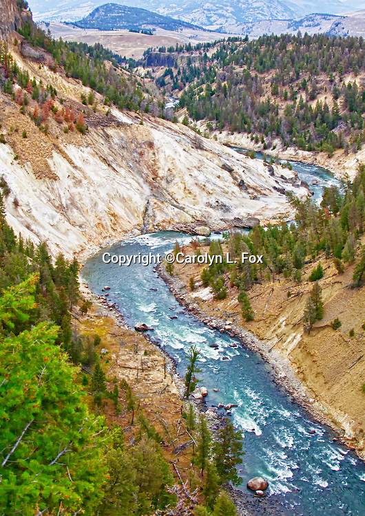 It seems like you can see forever from the Calcite Springs Overlook in Yellowstone National Park.  The Yellowstone River runs through the canyon.