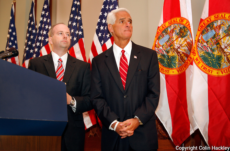 TALLAHASSEE, FL. 8/28/09-LEMIEUX CH08-George LeMieux, left, former chief of staff to Gov. Charlie Crist, right, listen to reporter's questions after Crist announced he will fill the U.S. Senate seat vacated by Mel Martinez, Friday at the Capitol in Tallahassee. LeMieux replaces Martinez who resigned the post and will serve a little more than a year in the role. Crist is running for the U.S Senate seat and hopes to win it in the November 2010 election...COLIN HACKLEY PHOTO
