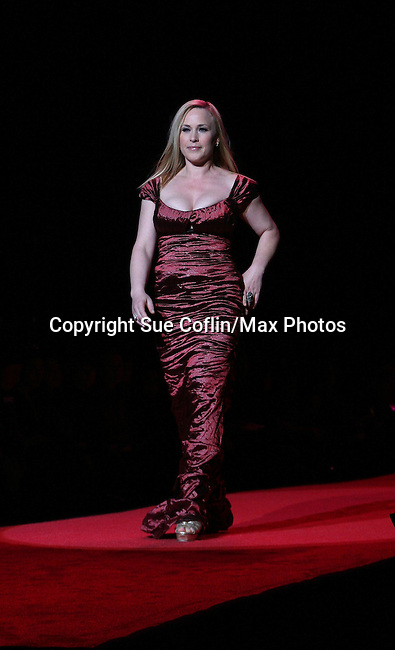 Actress Patricia Arquette of Medium wearing Nicole Miller walks the runway at The Heart Truth's Red Dress Collection 2009 Fashion Show which raises awareness that heart disease is the #1 killer of women was held during Mercedes -Benz Fashion Week New York Fall 09 on February 13, 2009 in Bryant Park, New York City, NY. This event unites with America's top designers to showcase a colleciton of one-of-a-kind Red Dresses. (Photo by Sue Coflin/Max Photos)