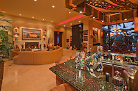 Well stock wet bar is seen with living and dining rooms in back ground