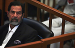 Saddam Hussein sits in the defendants docket during his trial in the heavily fortified green zone October 31, 2006 in Baghdad, Iraq.
