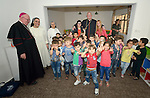 Cardinal Timothy Dolan, the archbishop of New York, poses with children displaced by war in a preschool run by the Dominican Sisters of St. Catherine of Siena in Ankawa, near Erbil, Iraq, on April 9, 2016. On the left is Bishop William Murphy of Rockville Centre, New York.<br /> <br /> Dolan, chair of the Catholic Near East Welfare Association, is in Iraqi Kurdistan with Murphy and other church leaders to visit with Christians and others displaced by ISIS. The Dominican Sisters were themselves displaced by ISIS, and have established schools and other ministries among the displaced.