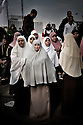 Muslim sisters ( female branch of the muslim brotherhood) in the demontration in Cairo. Thousands of Islamist and secular protesters gathered in Cairo's Tahrir Square today for a mass rally to press the ruling military to hand over power to a civilian government.