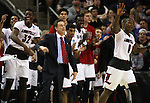 Louisville head coach Rick Pitino celebrates near the end of the game during their win against Northern Iowa State in the 2015 NCAA Division I Men's Basketball Championship's March 22, 2015 at the Key Arena in Seattle, Washington.  Louisville beat Northern Iowa State 66-53 to advance to the Sweet 16.