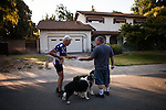 "SACRAMENTO, CA - JULY 3, 2014:  Sacramento City water waste inspector Ron Carpenter hands a violation notice to a resident on one of Sacramento's enforced ""no watering"" days. CREDIT: Max Whittaker for The New York Times"