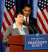 Chicago, IL - December 15, 2008 -- United States President-elect Barack Obama (R) listens to Lisa Jackson, (L) his nominee to run the EPA, during a news conference in Chicago, Illinois on Monday, December 15, 2008..Credit: Jeff Haynes / CNP