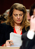 Washington, D.C. - March 23, 2004 -- Mindy Kleinberg of New Jersey, a 9/11 widow, follows the testimony of Secretary of Defense Donald Rumsfeld during the hearing of the National Commission on Terrorist Attacks Upon the United States (9/11 Commission) in Washington, DC on March 23, 2004.  <br /> Credit: Ron Sachs / CNP<br /> [RESTRICTION: No New York Metro or other Newspapers within a 75 mile radius of New York City]