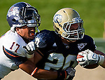 UTSA player, #17, Erik Brown  loses his hemet as he tackles UC Davis player, #20, Colton Silveria during second half action, as the UC Davis Aggies 38-17 victory over the University of Texas at San Antonio Roadrunners, Saturday Oct. 15, 2011.