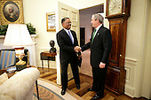 President George W. Bush welcomes U.S. Coast Guard Rear Admiral Stephen W. Rochon to the Oval Office Tuesday, Feb. 20, 2007.  The New Orleans native was announced Tuesday, Feb. 27, 2007, as Director of the Executive Residence and Chief Usher.  He will be the eighth Chief Usher of the White House.  White House photo by Eric Draper