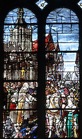Stained glass window, 1974, by Michel Durand, of the visit of Henri IV to Le Havre, in the choir of Le Havre Cathedral, or Cathedrale Notre-Dame du Havre, built in the 16th and 17th centuries and made cathedral in 1974, on the Rue de Paris in Le Havre, Normandy, France. This is one of the few buildings in the town to survive the bombings during the Second World War, although it did sustain heavy damage. Only 2 of the original stained glass windows survived. The centre of Le Havre is listed as a UNESCO World Heritage Site. Picture by Manuel Cohen.