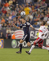 New England Revolution midfielder Chris Tierney (8) heads the ball as New York Red Bulls forward Dane Richards (19) defends. The New England Revolution defeated the New York Red Bulls, 3-2, at Gillette Stadium on May 29, 2010.
