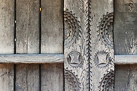 "Carved Wooden vernacular shed door detail built by ""Pasco of the Salaje"" (county Salaj) in 1775, Berbesti, Maramures. Dimitrie Gusti National Village Museum (Muzeul Satului) in Bucharest, Romania"