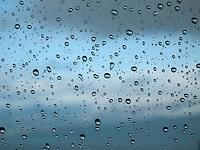 Rain Drops on Window Pane During Storm