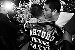 ARTURO GATTI (11/12) -- A fan reaches out and kisses Arturo as he is led from the ring to his dressing room after being beaten by TKO at the hands of top-ranked contender Floyd Mayweather, Jr. before a sellout pro-Gatti crowd at Atlantic City's Boardwalk Hall.  ATLANTIC CITY, NJ  6/25/05