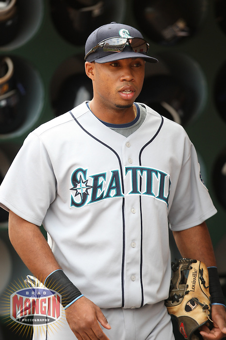 OAKLAND, CA - SEPTEMBER 20:  Luis Valbuena of the Seattle Mariners gets ready in the dugout before the game against the Oakland Athletics at the McAfee Coliseum in Oakland, California on September 20, 2008.  The Athletics defeated the Mariners 8-7.  Photo by Brad Mangin