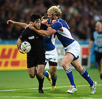 Nehe Milner-Skudder of New Zealand is tackled by Conrad Marais of Namibia. Rugby World Cup Pool C match between New Zealand and Namibia on September 24, 2015 at The Stadium, Queen Elizabeth Olympic Park in London, England. Photo by: Patrick Khachfe / Onside Images