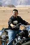 King Abdullah II of Jordan on motorcycle in Wadi Rum