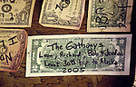Our $2.00 bill.  Visitors sign dollar bills and post them on the walls and ceiling at The Forks Roadhouse. - Petersville Road 20 miles from Trapper Creek.    Bob Gathany photo.