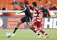 Jordan Graye #16 of D.C. United takes a shot past Bruno Guarda #8 of F.C. Dallas during a US Open Cup match on April 28 2010, at RFK Stadium in Washington D.C. D.C. United won 4-2.