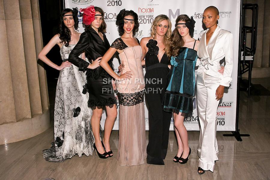 Fashion designer Stella Simona poses with models infront of backdrop during Nolcha Fashion Week, September 14, 2010.