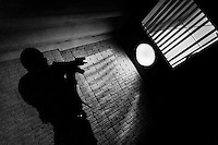 A policeman from the special anti-gang unit (Unidad Antipandillas) aims rifle at the window during a night raid in Soyapango, a gang neighborhood in San Salvador, El Salvador, 13 December 2013. During the last two decades, Central America has become the deadliest region in the world that is not at war. According to the UN statistics, more people per capita were killed in El Salvador than in Iraq, in recent years. Due to the criminal activities of Mara Salvatrucha (MS-13) and 18th Street Gang (M-18), the two major street gangs in El Salvador, the country has fallen into the spiral of fear, violence and death. Thousands of Mara gang members, both on the streets or in the overcrowded prisons, organize and run extortions, distribution of drugs and kidnappings. Tattooed armed young men, mainly from the poorest neighborhoods, fight unmerciful turf battles with their coevals from the rival gang, balancing between life and death every day. Twenty years after the devastating civil war, a social war has paralyzed the nation of El Salvador.