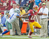 Washington Redskins wide receiver Josh Doctson (18) runs away from Dallas Cowboys free safety Byron Jones (31) in fourth quarter action at FedEx Field in Landover, Maryland on Sunday, September 18, 2016.  The Cowboys won the game 27 - 23.<br /> Credit: Ron Sachs / CNP /MediaPunch