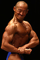 June 6, 2010 - Tokyo, Japan - A Japanese bodybuilders flexes his muscles during a regional bodybuilding competition on June 6, 2010 in Tokyo, Japan. A total of 116 male bodybuilders took part in the competition hosted at Hoku Topia hall on Sunday.