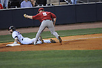 Ole Miss' Tanner Mathis (12) beats the tag of Alabama third baseman Brett Booth (5) at Oxford-University Stadium in Oxford, Miss. on Friday, March 18, 2011. Mathis singled and made it to third on a two-base error on Alabama right fielder Brandt Hendricks. Ole Miss won 4-0. The Rebels are 15-4 on the season and 1-0 in SEC play.  (AP Photo/Oxford Eagle, Bruce Newman)